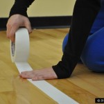 picture of person taping a court for allabouttape.com